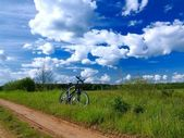 Bicycle in countryside — Stock Photo