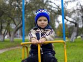 Boy swinging — Stock Photo