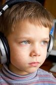 Little boy in ear-phones — Stock Photo