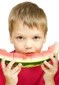 Boy eating a piece of watermelon — Stock Photo