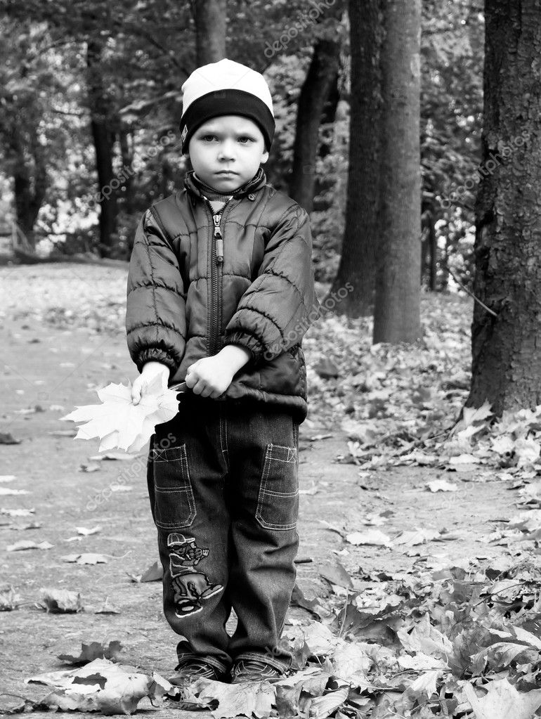 Black-and-white portrait of the boy in autumn park. A sight full of hope for the leaving favourite person. This farewell... — Foto de Stock   #1023463