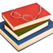 Stock Photo: Glasses on pile of books