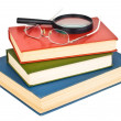Royalty-Free Stock Photo: Glasses on a pile of books