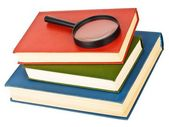 Magnifying glass on a pile of books — Stock Photo