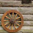 Hand Spinning Wheel On The Log House Wal - Stock Photo