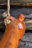 Ceramic Bottle On The Rope — Stock Photo