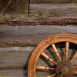 Stock Photo: Spinning Wheel On Log Hut Wall