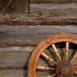 Stock Photo: Spinning Wheel On The Log Hut Wall