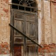 Stock Photo: Boarded Up Door To Church