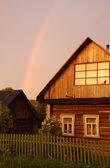 Rainbow Over Russian Village — Stock Photo