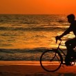 Stock Photo: Cycling At Sunset On Beach