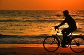 Cycling At Sunset On The Beach — Stock Photo