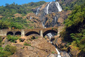 Dudhsagar Waterfalls and Railroad Bridge — Stock Photo