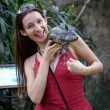 Portrait photo of girl with iguana - Stock Photo