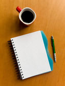 Cup of coffee and notebook — Stock Photo