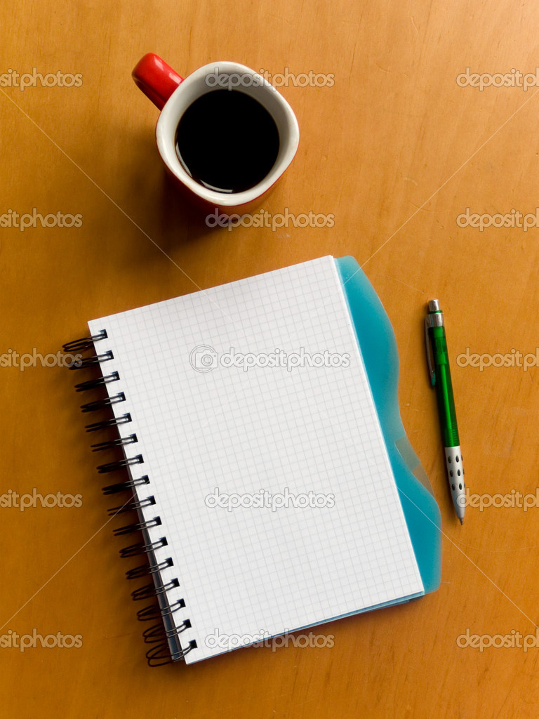 Coffee cup, spiral squared notebook and pen on the wooden table. Viewed from above. — Stock Photo #1010994