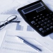 Calculator and glasses — Stock Photo #1028620