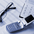 Phone, daily book and glasses - Stock Photo