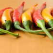 Red and yellow chili peppers — Stock Photo