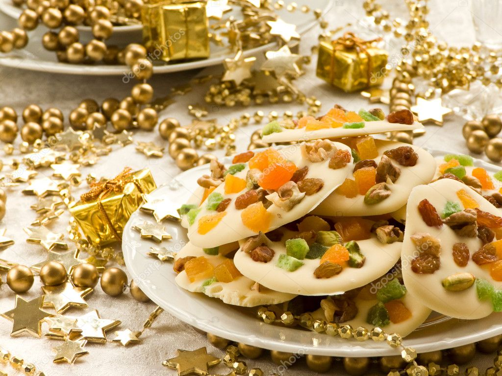 Homemade white chocolate cookies decorated with dried apricots, pistachios, raisin, candied fruits and walnuts. Shallow dof.  Stock Photo #1680238