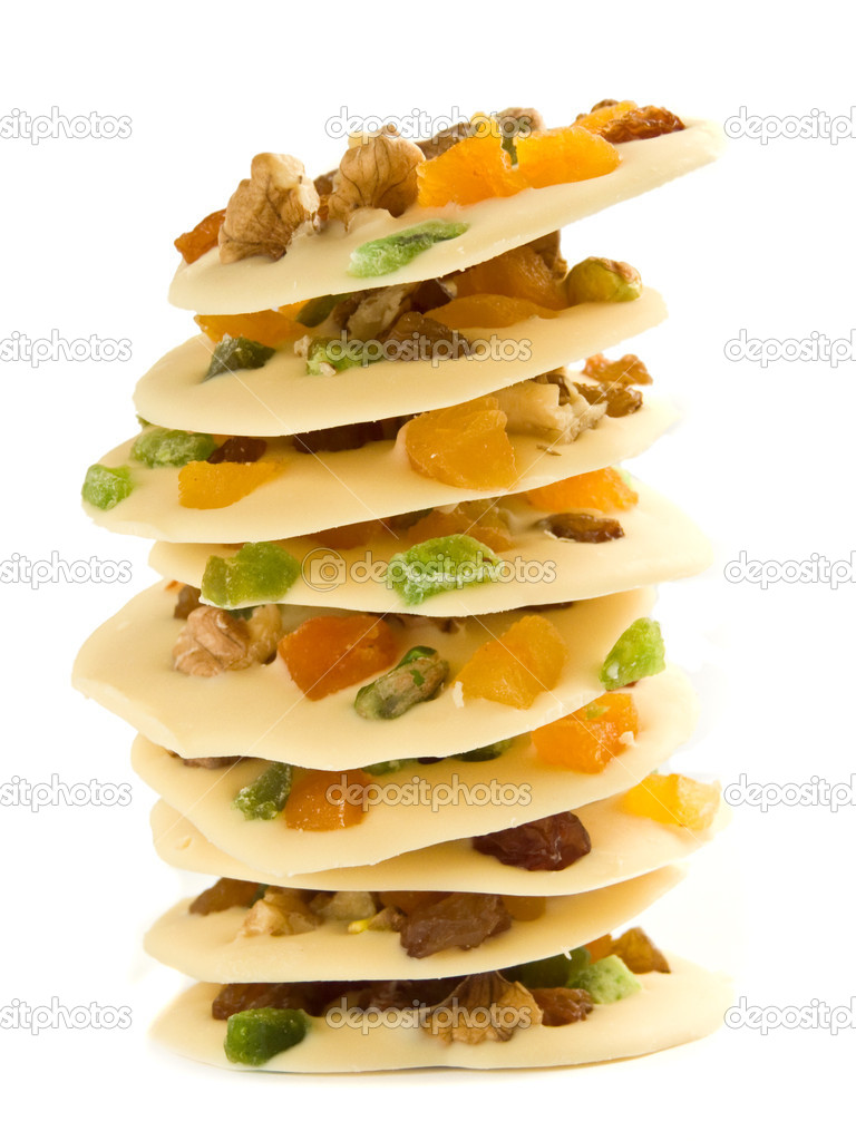 Stack of the homemade white chocolate cookies decorated with fruits and nuts, isolated over white. — Stock Photo #1680317