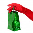 Hand with gift bag — Stock Photo