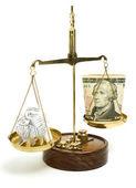 Money on a balance scale — Stock Photo