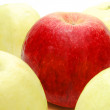 Red Apple between Yellow — Stock Photo #1264589