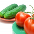 Red Tomatoes and Cucumbers on Plate — Stock Photo