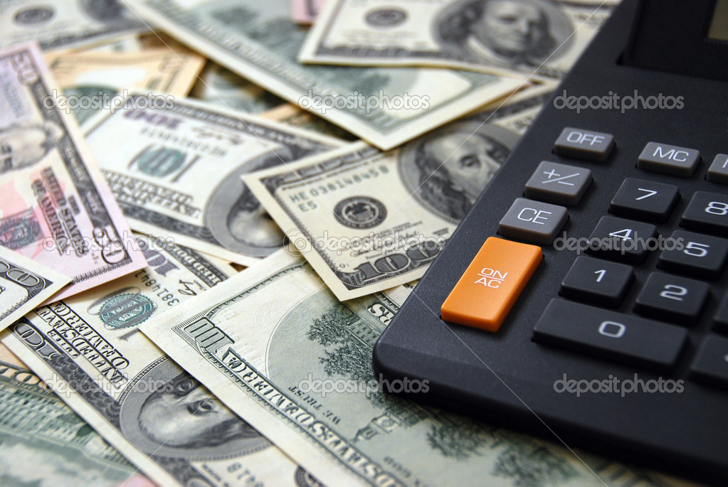 Calculator on money background of $100 and $50 banknotes — Stock Photo #1035088