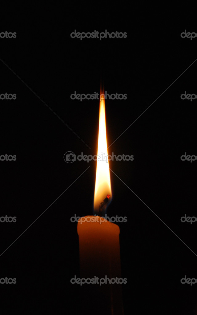 Flame of a candle in full darkness — Foto de Stock   #1081912