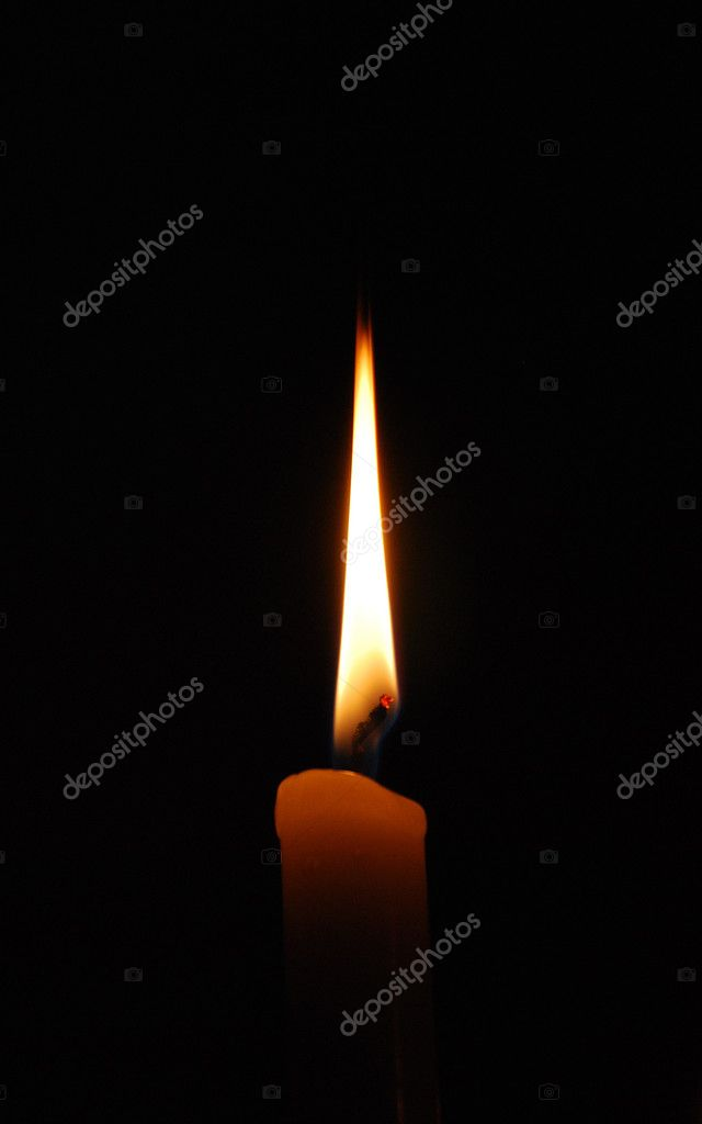 Flame of a candle in full darkness   #1081912