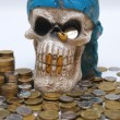 Coins & skull - Stock Photo