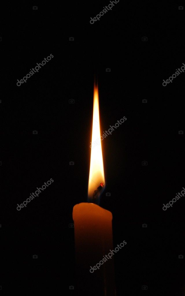 Flame of a candle in full darkness  Stock Photo #1825545