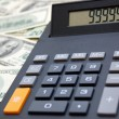 Calculator on money background — Stock Photo