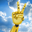Golden robotic hand showing victory — Stock Photo
