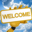 "Gold robotic hand hold a plate with word ""welcome"". Including clipping path. — Stock Photo #1028627"