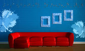 Red couch with empry frames in minimalis — Stock Photo