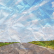 Crumpled empty road with blue sky above — Stock Photo