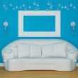 Sofa with sconces and empty frame — Stock Photo