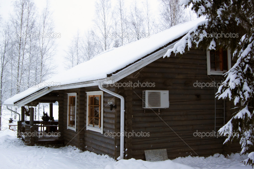 Wooden cottage covered by snow  — Stock Photo #1704228