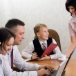 Stock Photo: Young boy as boss in office with e
