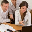 Office team of young with a lapto — Stock Photo