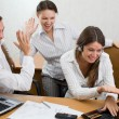 Stock Photo: Office team with laptops and clap gestur