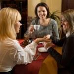 Beautiful girls chatting at tea — Stock Photo