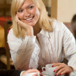 A blond in a cafe at tea — Stock Photo