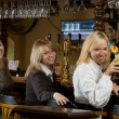 Three pretty girls at a bar counter — Stock Photo #1024150