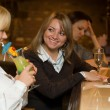 Young women in a bar with cocktail and w — Stock Photo
