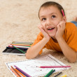 Royalty-Free Stock Photo: Kid with pencils on the carpet.