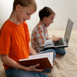 Stock Photo: Two children with books and laptop